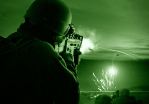 Special operations forces in a firefight during a night operation.