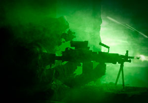 U.S. Army Ranger in a firefight during a night operation.