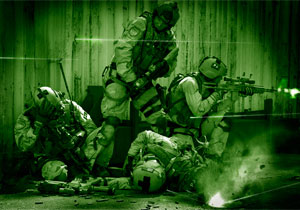 U.S. Special operations forces in a firefight during a night operation.