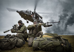 Two special operations forces scout snipers are picked up by a blackhawk helicopter.