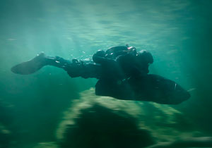 A Special Operations Forces combat swimmer with a diver propulsion vehicle.