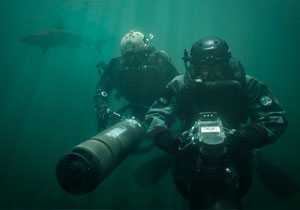 Two Special Operations Forces combat diver with diver propulsion vehicle.