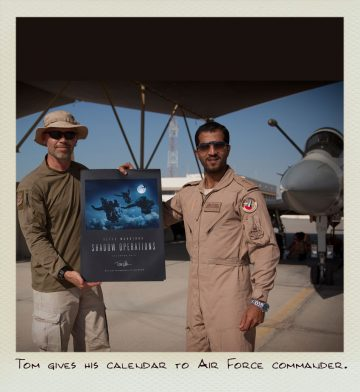 Tom (MILPICTURES) gives his calendar to the Air Force Commander.
