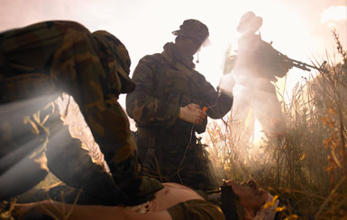 Combat medics provide a wounded soldier.