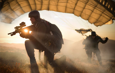 Special Operations Forces paratroopers secure the landing zone in the sunset.